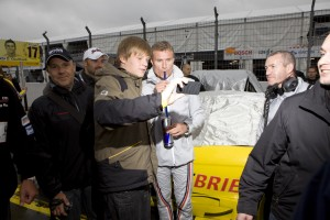A fan photographs himself and David Coulthard