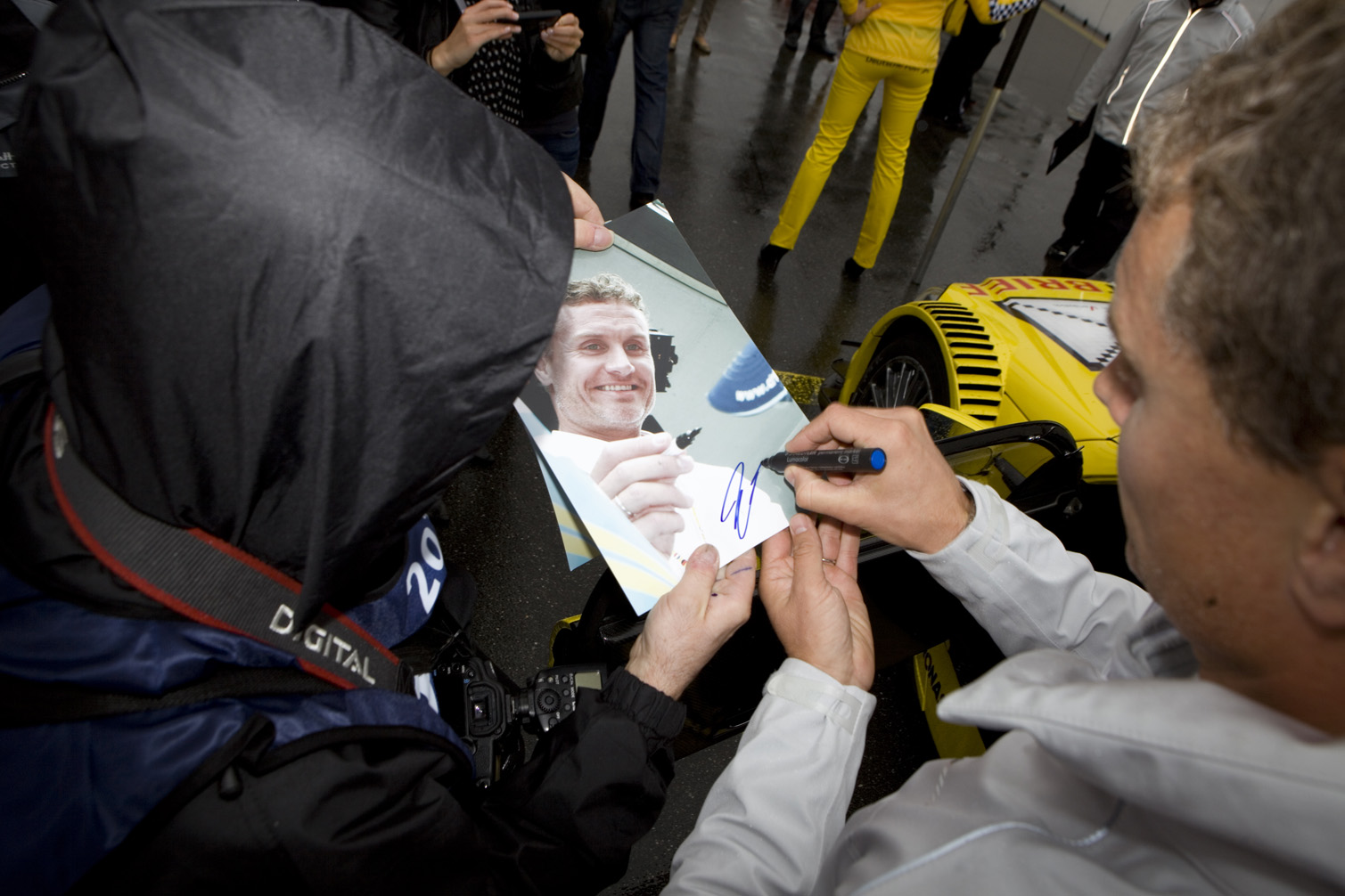 David Coulthard signs pictures for fans in Germany