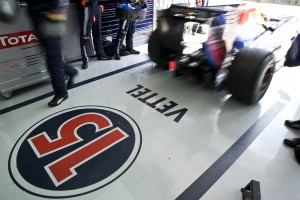 Vettels Red Bull Racing car zooms out of the garage