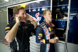 team principle Christian Horner and Sebastian Vettel watching the qualifying session on the garage TV's