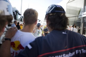 Sebastian Vettel stops to have his photo taken with fans at the Hungarian Grand Prix