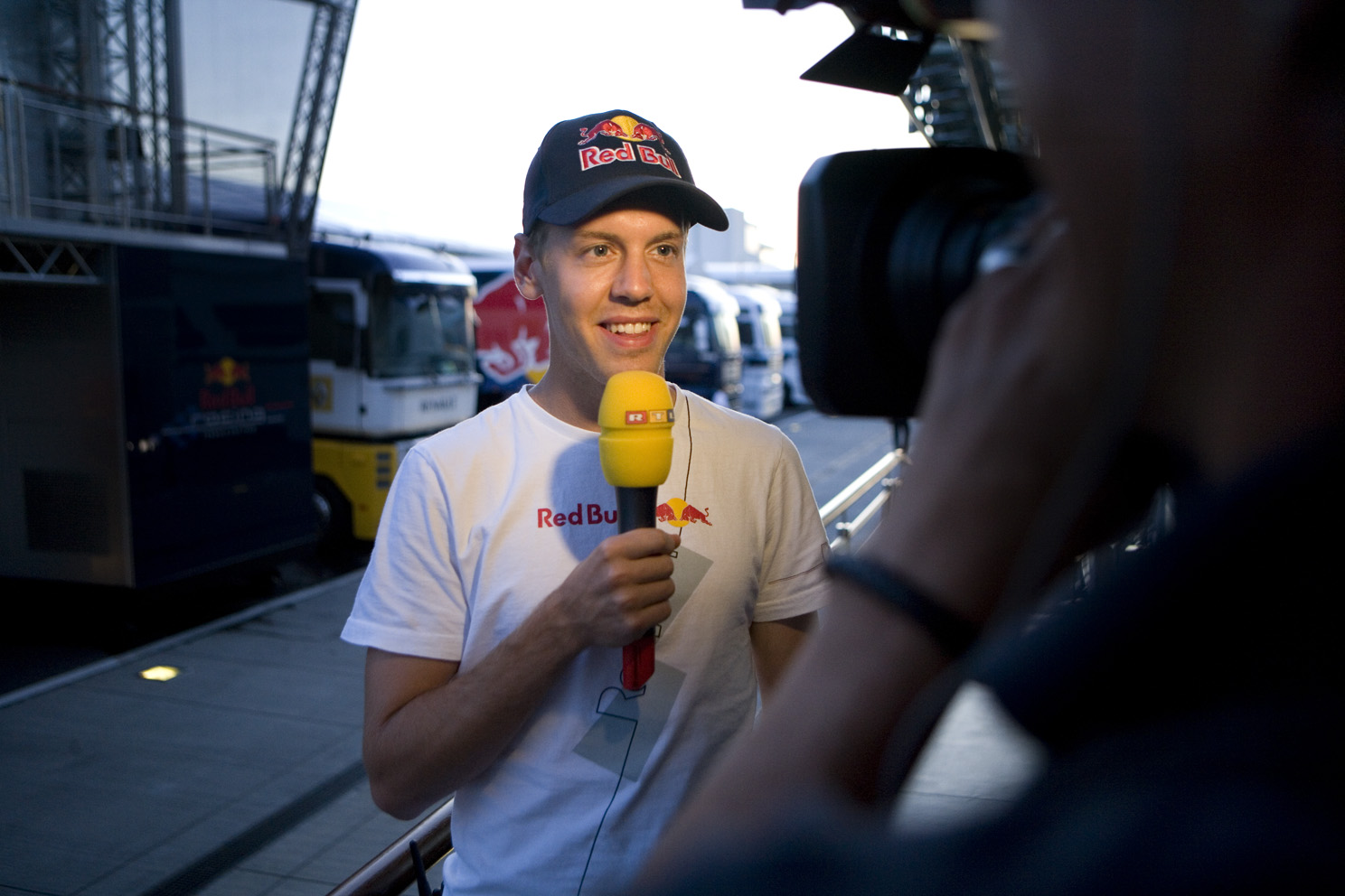 Sebastian Vettel talks to the international media, at the Hungarian Grand Prix