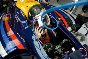 Sebastian Vettel sits in his car