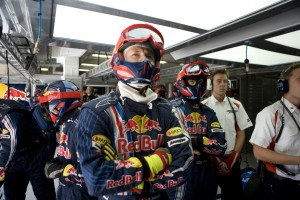 The Red Bull Racing pit crew, watches the TV Screens