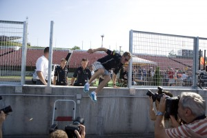 Red Bull Racings Sebastian Vettel runs away from photographers at the Hungarian Grad Prix