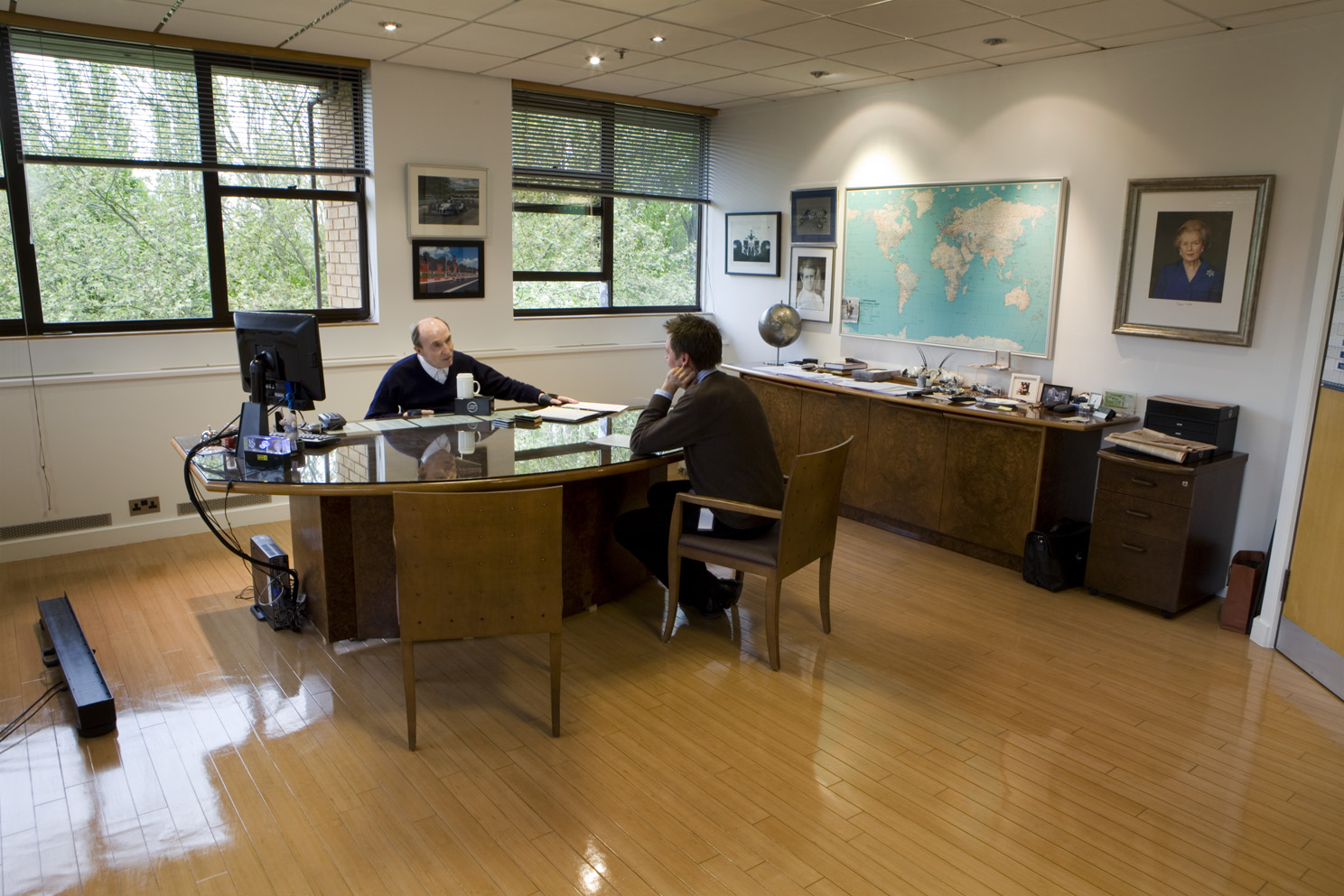 Sir Frank Williams team principal of the Williams Formula One team with Tom Clarkson of Car magazine