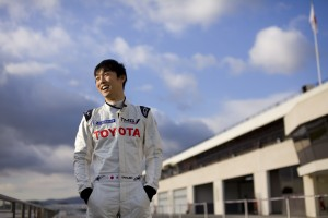 Driver Kazuki Nakajima chats with media before taking the car out