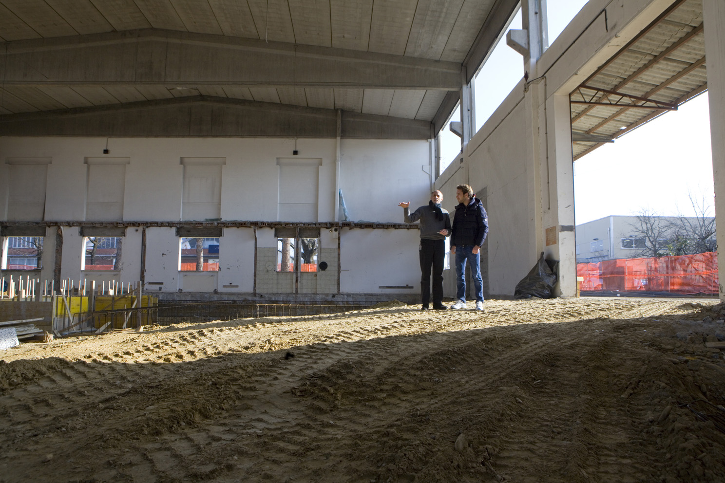 Franz Tost shows Jean-Eric Vergne around the site of the newest part of the Toro Rosso factory