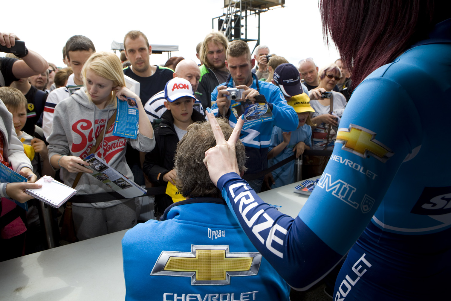 Signs autographs for fans at the Croft Circuit.