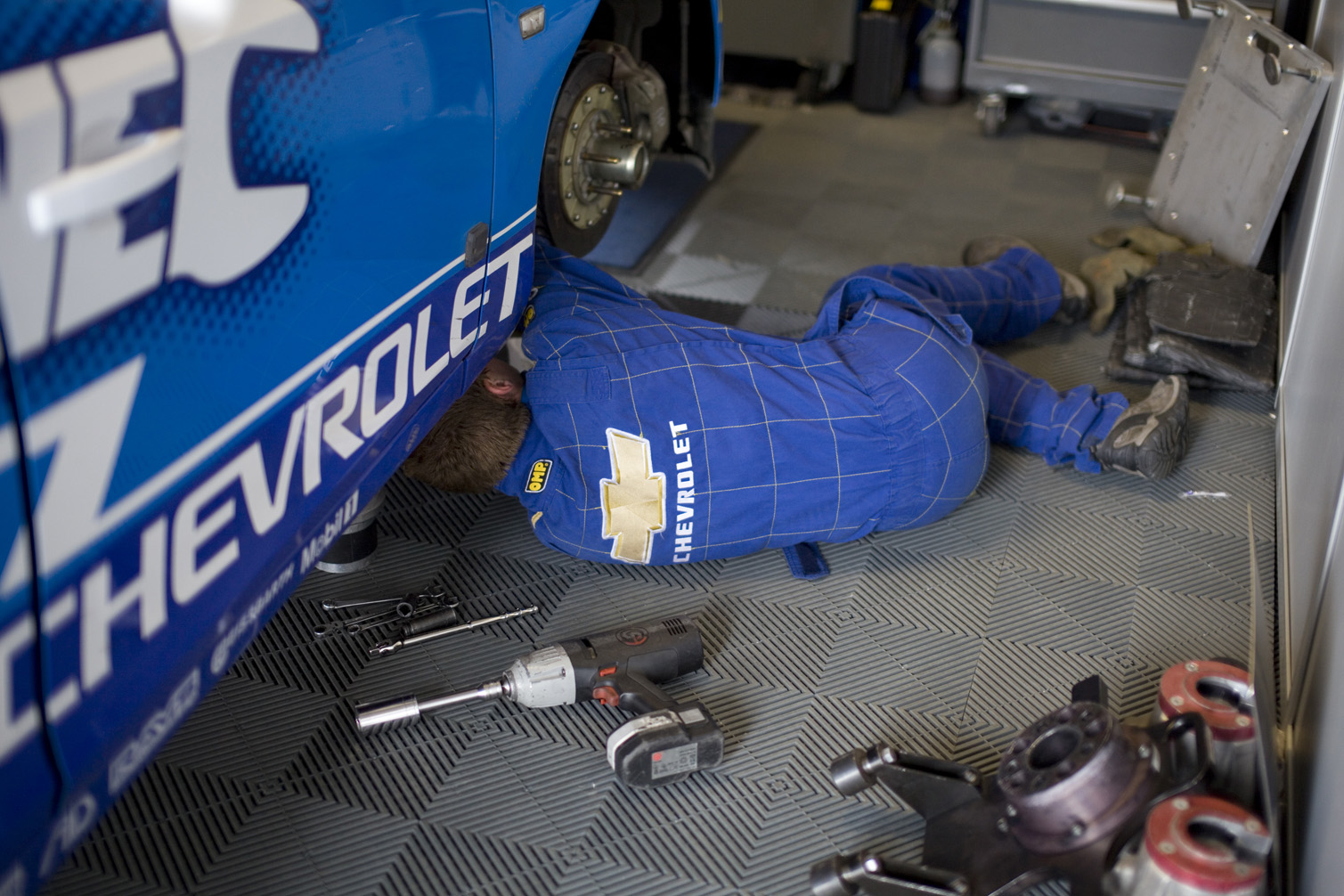 A Chevrolet mechanic works on Jason's car.