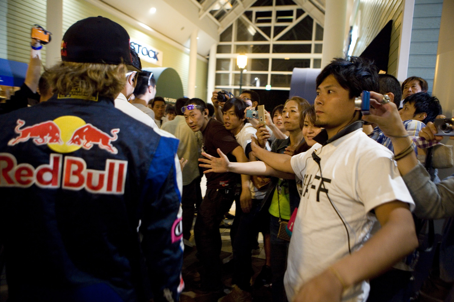 Red Bull and Citroën driver Kimi Räikkönen racing electric carts in a shopping centre in Japan.