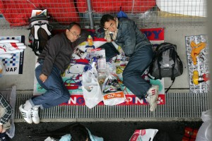 Fans sheltering from the rain at the Japanese Grand Prix