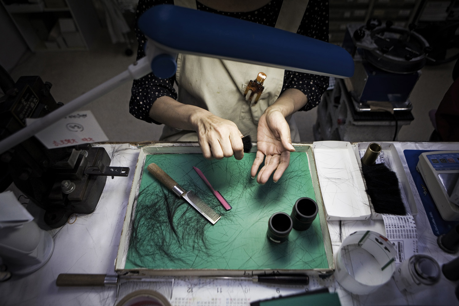 A worker making make-up brushes