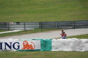 A photographer shoots trackside at the Malasian Grand Prix