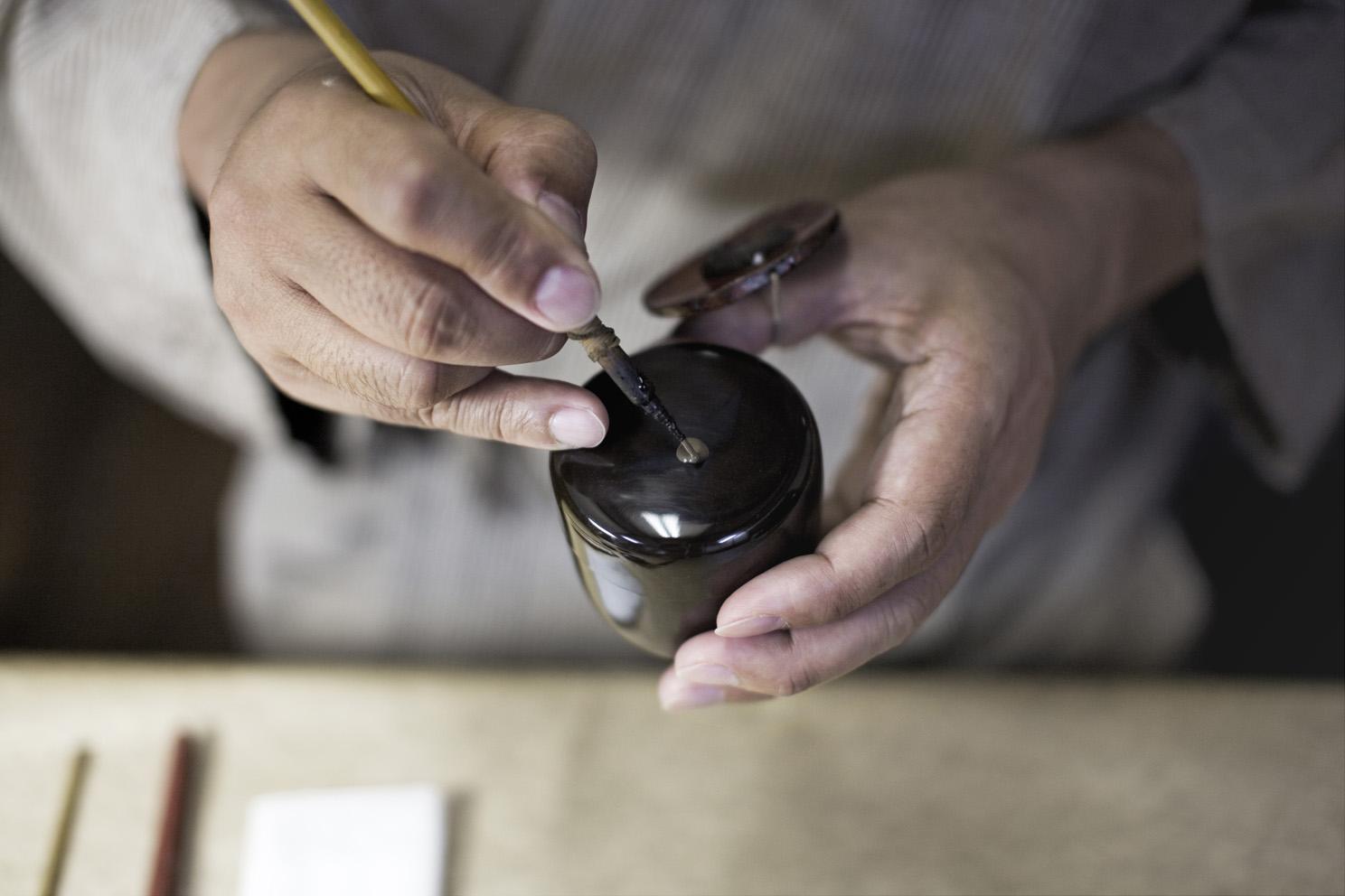 Mr Ikeda works on a peice