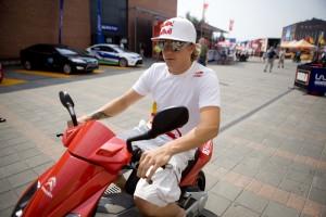 Kimi Raikkonen, on a bike (red)