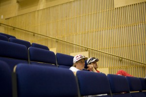 Kimi Raikkonen and Sebastien Loeb wait for the drivers meeting