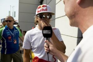 Kimi Raikkonen talks to the media