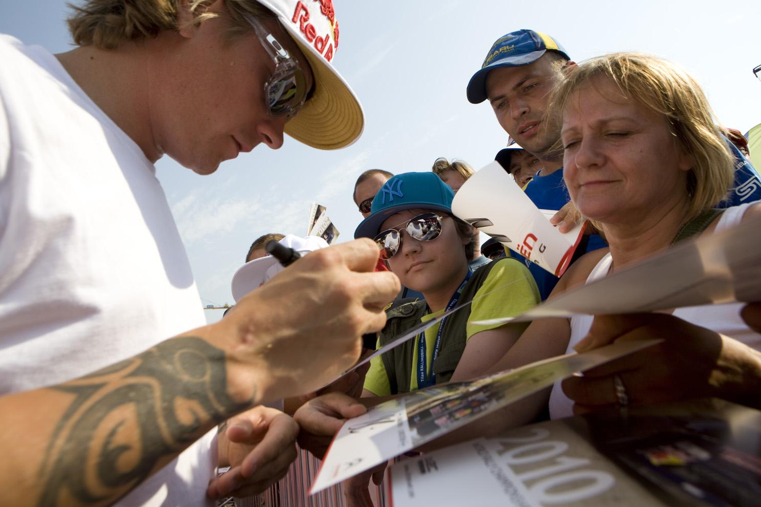 Kimi Raikkonen signs autographs
