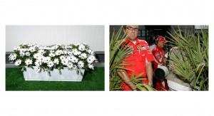 Flowers outside Bernies truck, Michael Schumacher walks through the paddock