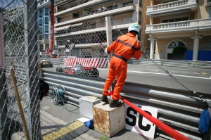 A marshall gets a good look at the cars during the Monaco Grand Prix