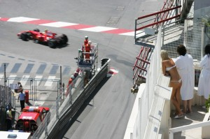 Sun worshipers take a break from tanning to watch the race, at the Monaco Grand Prix