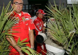 Michael Schumacher and team, squeeze through the paddock at the Canadian Grand Prix