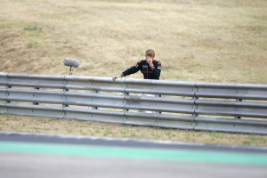 Jenson Button watches the rest of the race from the barriers after crashing out of the Hungarian Grand Prix