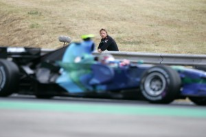 Jenson Button watches his Honda team mate, Rubens Barrichello, pass by. Hungary 2007