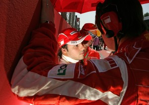 Felipe Massa talks to his team on the starting grid before the French Grand Prix 2007
