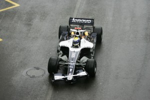 Battered and a little bit on fire, Williams Nico Rosberg limps round the Monaco circuit 2008