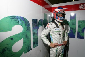 Jenson Button focused, waits for his car to be prepared