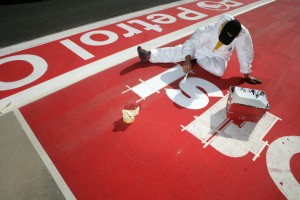 Preparing the track advertising for the Bahrain Grand Prix