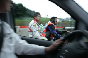 After crashing out of the Belgian Grand Prix, Giancarlo Fisichella is whisked back to the paddock by a marshal