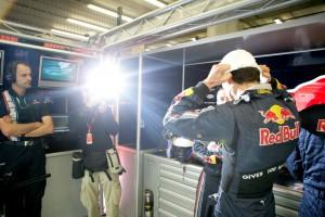 Mark Webber gets shot in the Red Bull garage before the Belgian Grand Prix