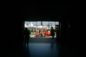 The Ferrari team pushes one of the cars to the scrutineering at the Melbourne Grand Prix 2008