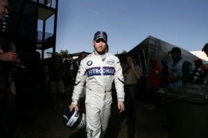 Nick Heidfeld walks through the pit lane at the Australian Grand Prix
