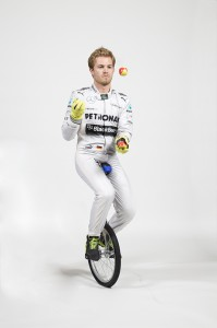 Nico Rosberg, Mercedes F1 Driver, juggles while riding a unicycle, not easy.