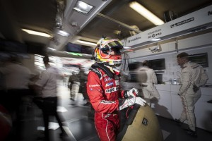 Timo Bernhard rushes through the garage